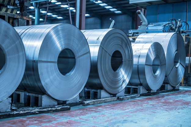 industrial-background-big-size-steel-coil-stored-inside-industrial-warehouse-blue-toned-image_56854-2869